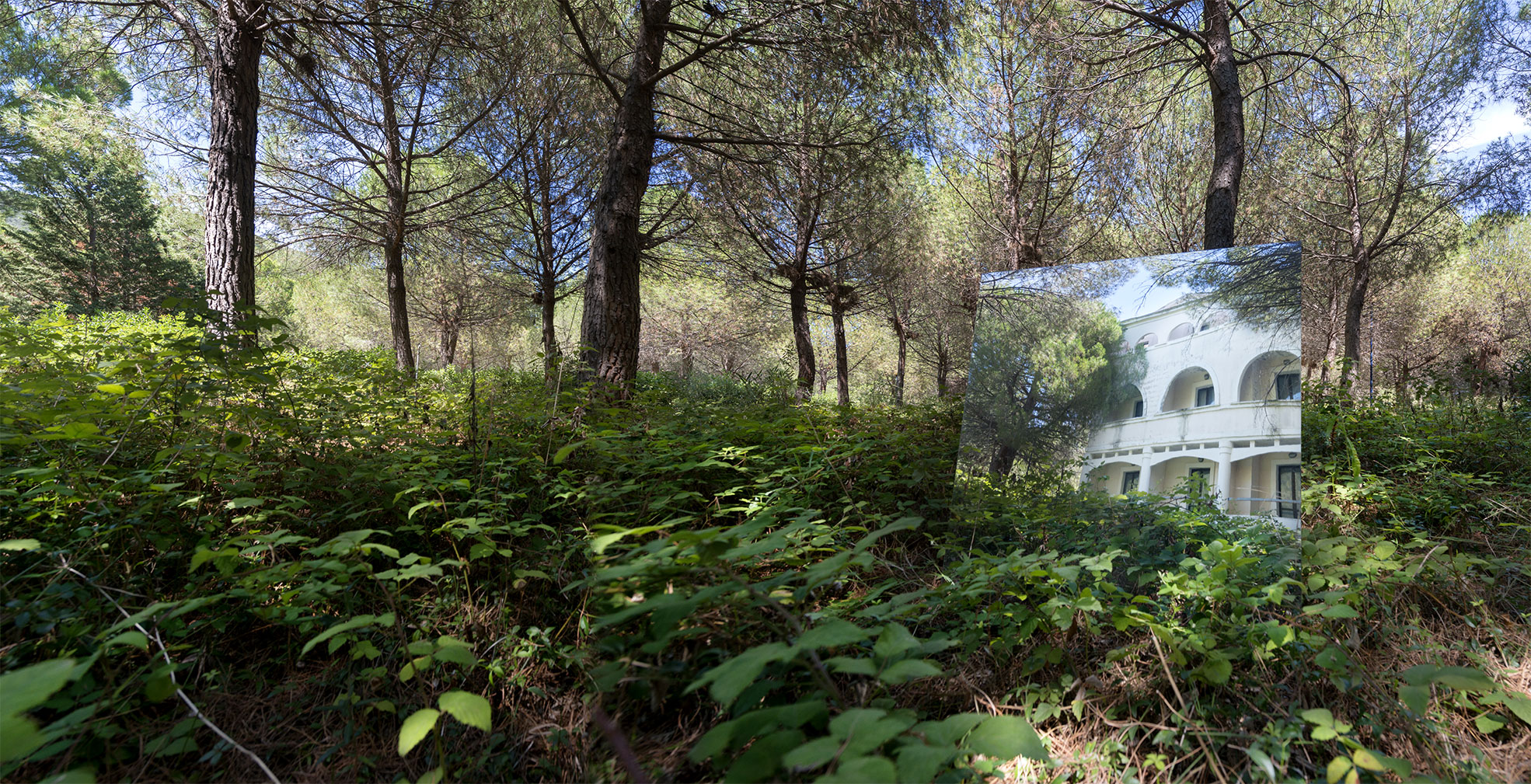 White facade reflected in a mirror one of the photo of the project Ecomostro tour Photographer Maria Teresa Furnari