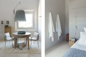 Bedroom and table detail with dog of Malatetsa Maison de Charme in the marche hills Photographer Maria Teresa Furnari