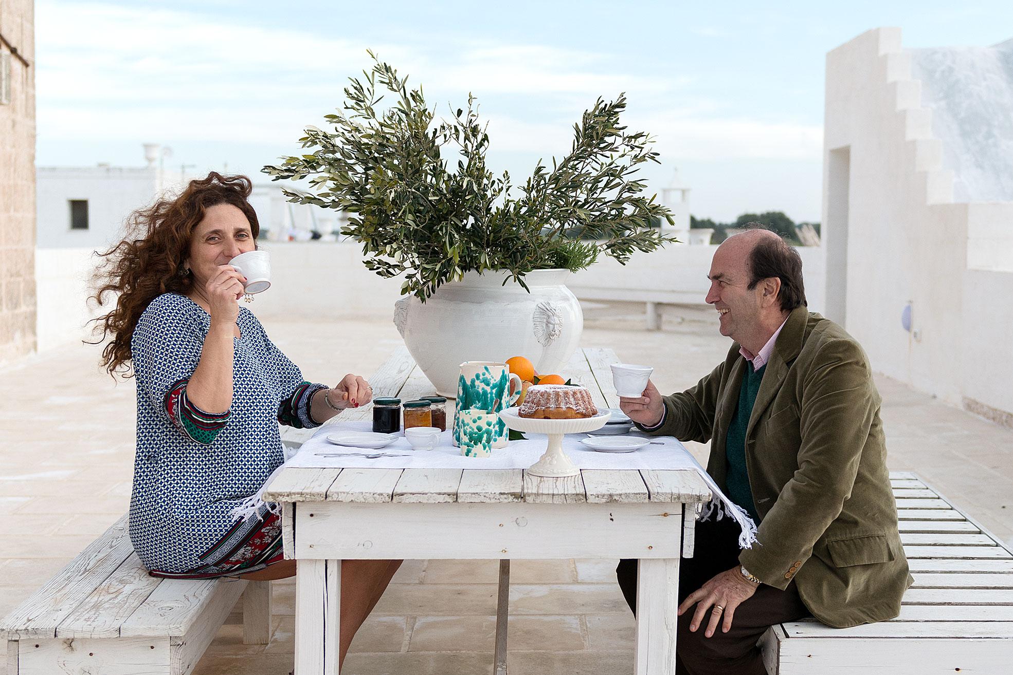 A couple doing breakfast in terrace at Masseria Potenti in Puglia Photographer Maria Teresa Furnari
