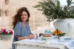A woman doing breakfast in terrace at Masseria Potenti in Puglia Photographer Maria Teresa Furnari