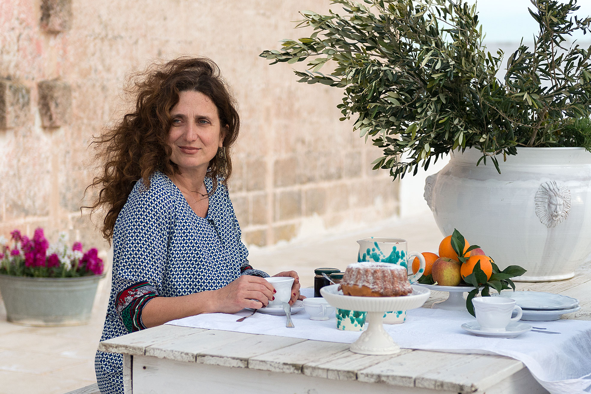 A woman doing breakfast in terrace at Masseria Potenti in Puglia Photographer Maria Teresa Furnari