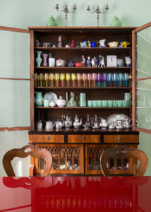 Colored glasses in a book shelf of Elena Corner's house Photographer Maria Teresa Furnari