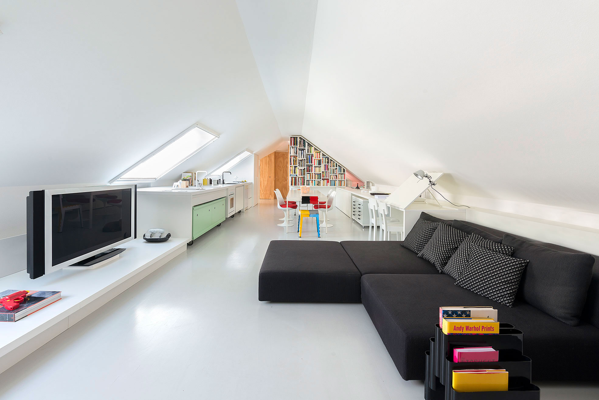 Living room and Kitchen in an attic apartment Photographer Maria teresa Furnari