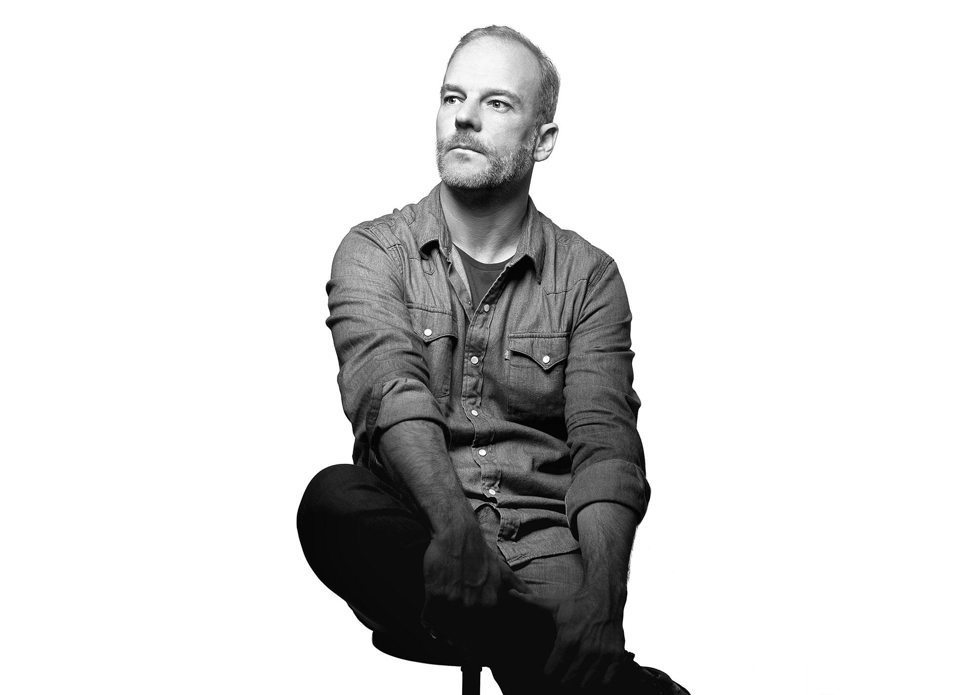 Black and white portrait half-length shot of the Architect Alessio Riva Photographer Maria Teresa Furnari
