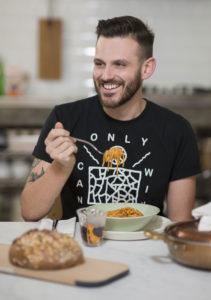 Portrait of Stefano Paleari founder of Gnambox eating spaghetti Photographer Maria Teresa Furnari