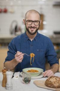 Portrait of Riccardo Casiraghi founder of Gnambox eating spaghetti Photographer Maria Teresa Furnari