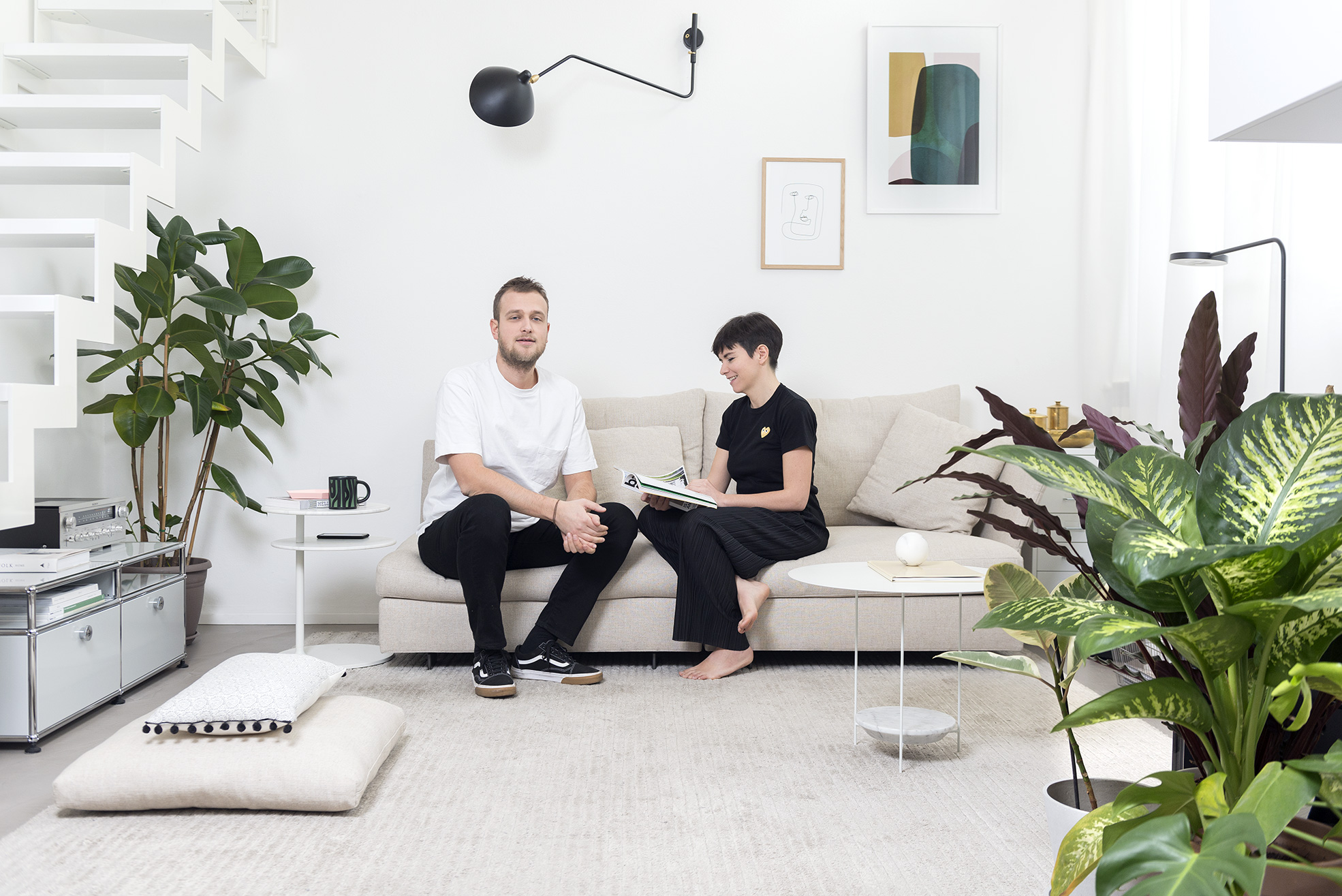 Portrait on sofa of Riccardo Crenna and Simona Flacco, founders of Simple Flair, in their Simple Flair Apartment Photographer Maria Teresa Furnari