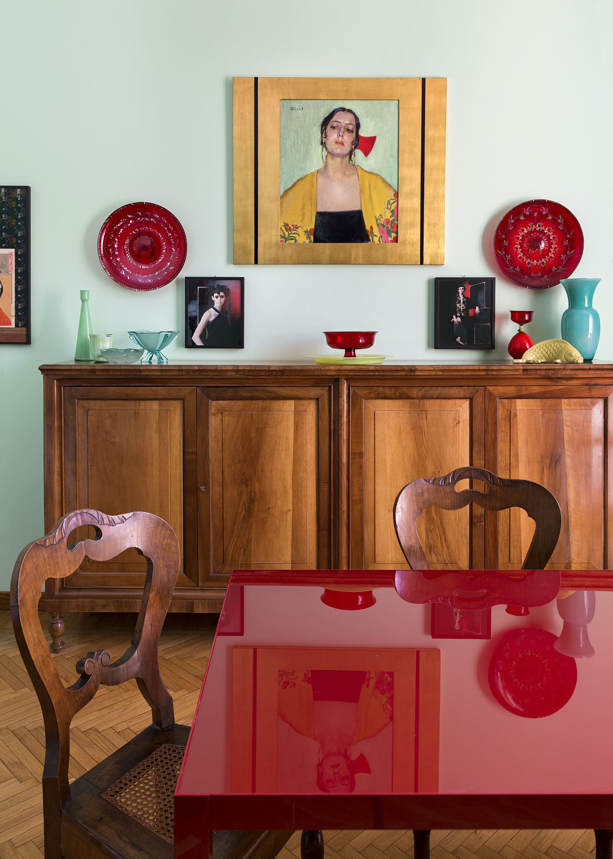 Red table in the Dining room of Elena Corner's house Photographer Maria Teresa Furnari