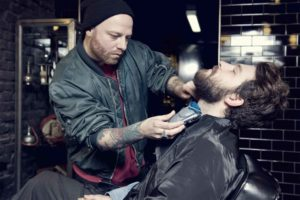 Stefano Terzuolo woking in his vintage barber shop GUM Photographer Maria Teresa Furnari