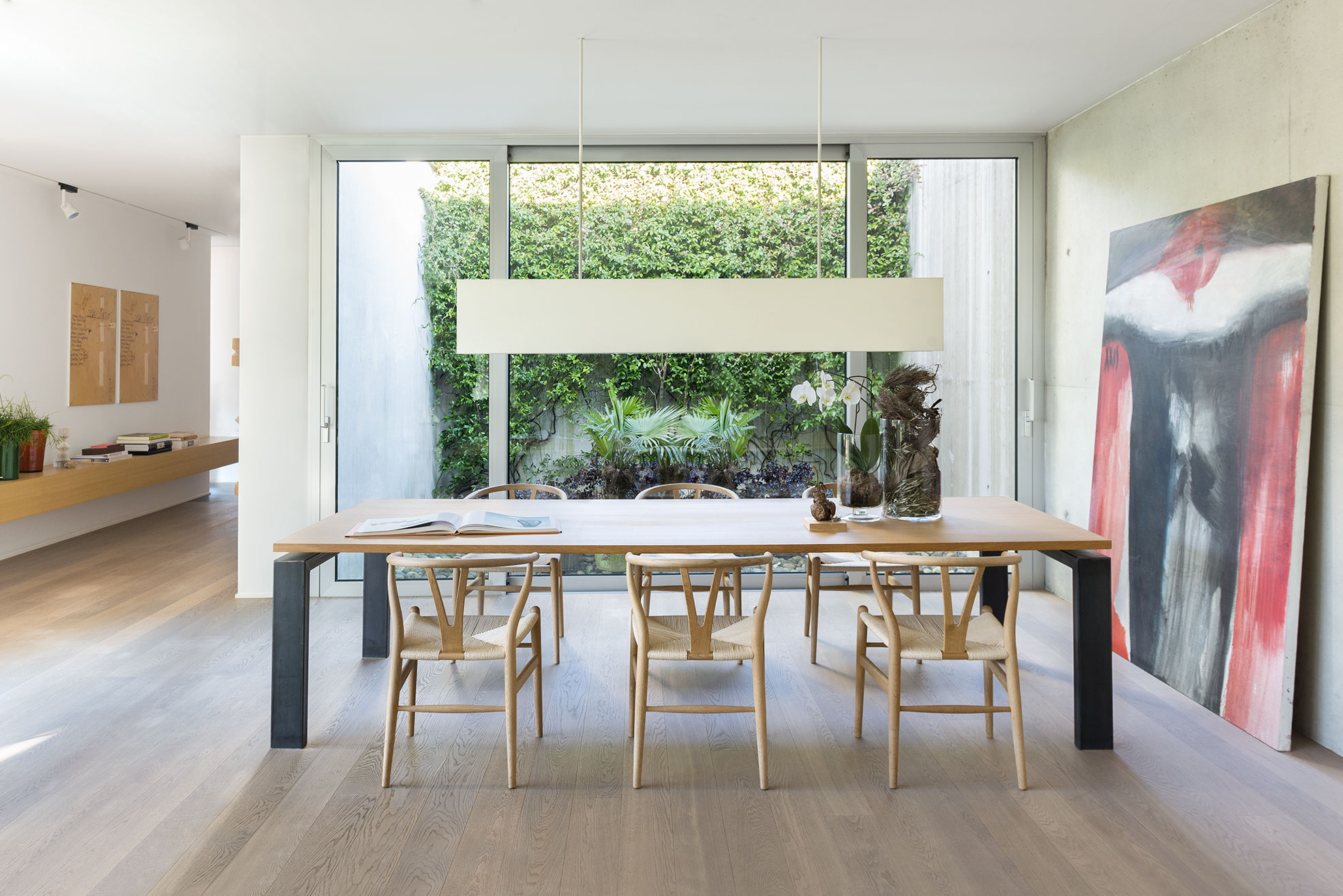 Wooden table in the living room of the concrete and minimalist villa of Rosalba Piccinni Photographer Maria Teresa Furnari