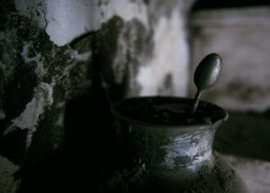 A vase full of mud and a spoon one of the trail of Giampilieri after the flood Photographer Maria Teresa Furnari