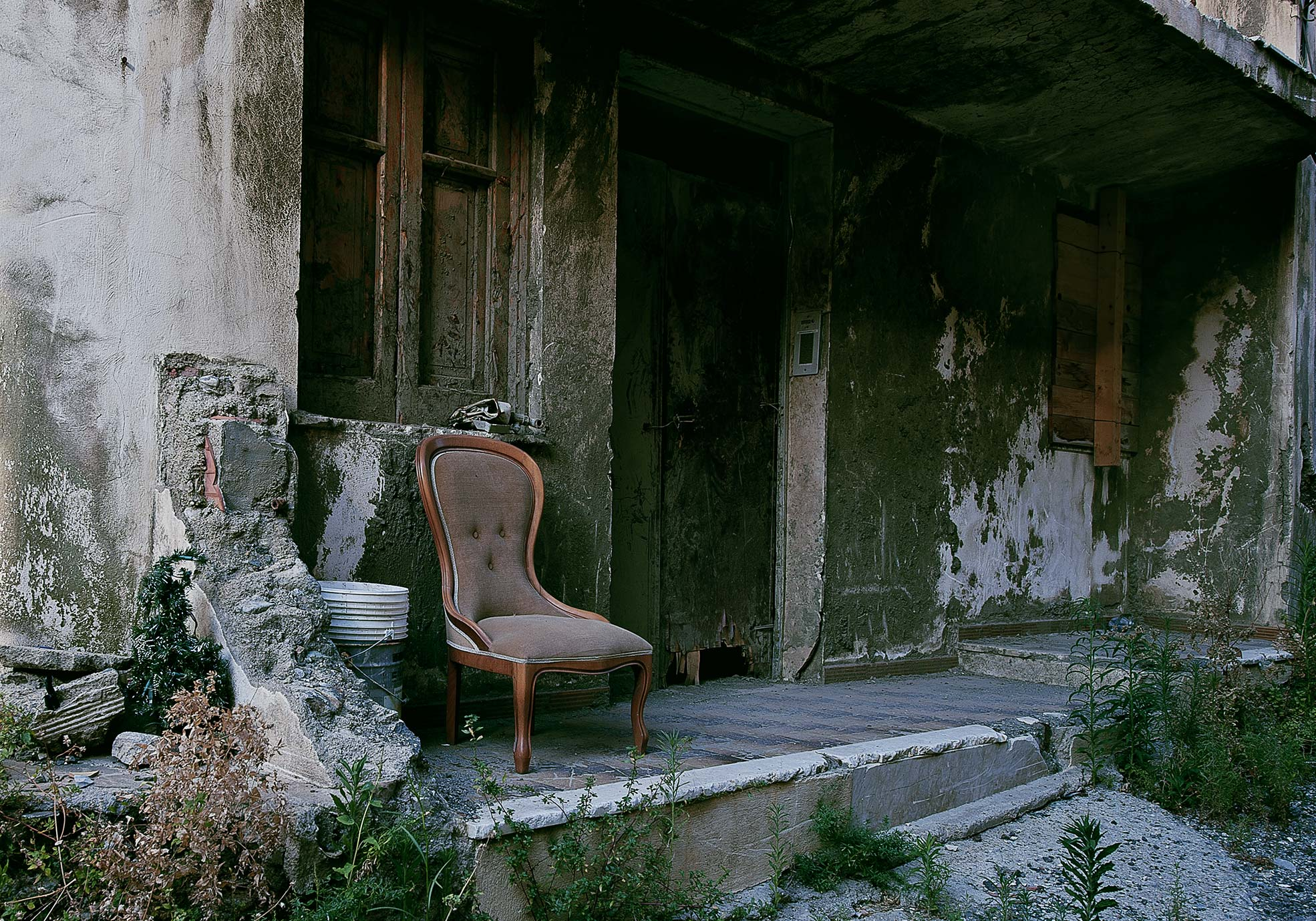 An armchair in a ruined house one of the trail of Giampilieri after the flood Photographer Maria Teresa Furnari