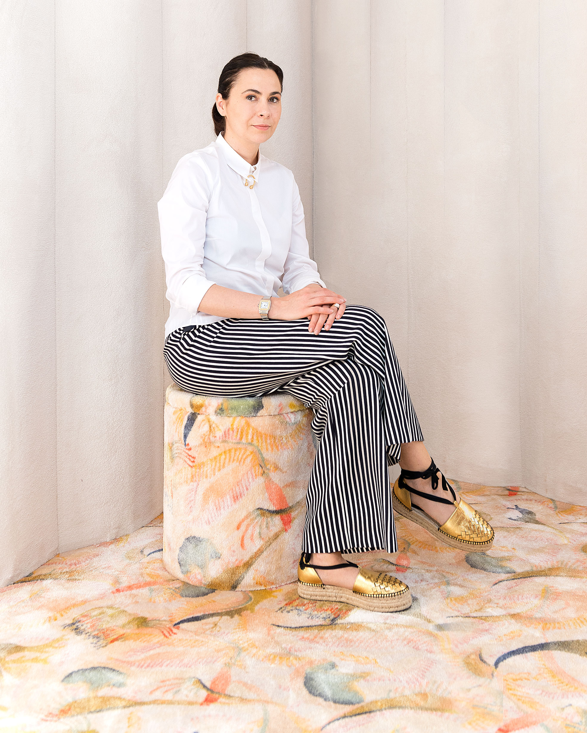 Portrait of the designer Cristina Celestino on Sabaitalia sofa at Brera Design Apartment Photography of Maria Teresa Furnari