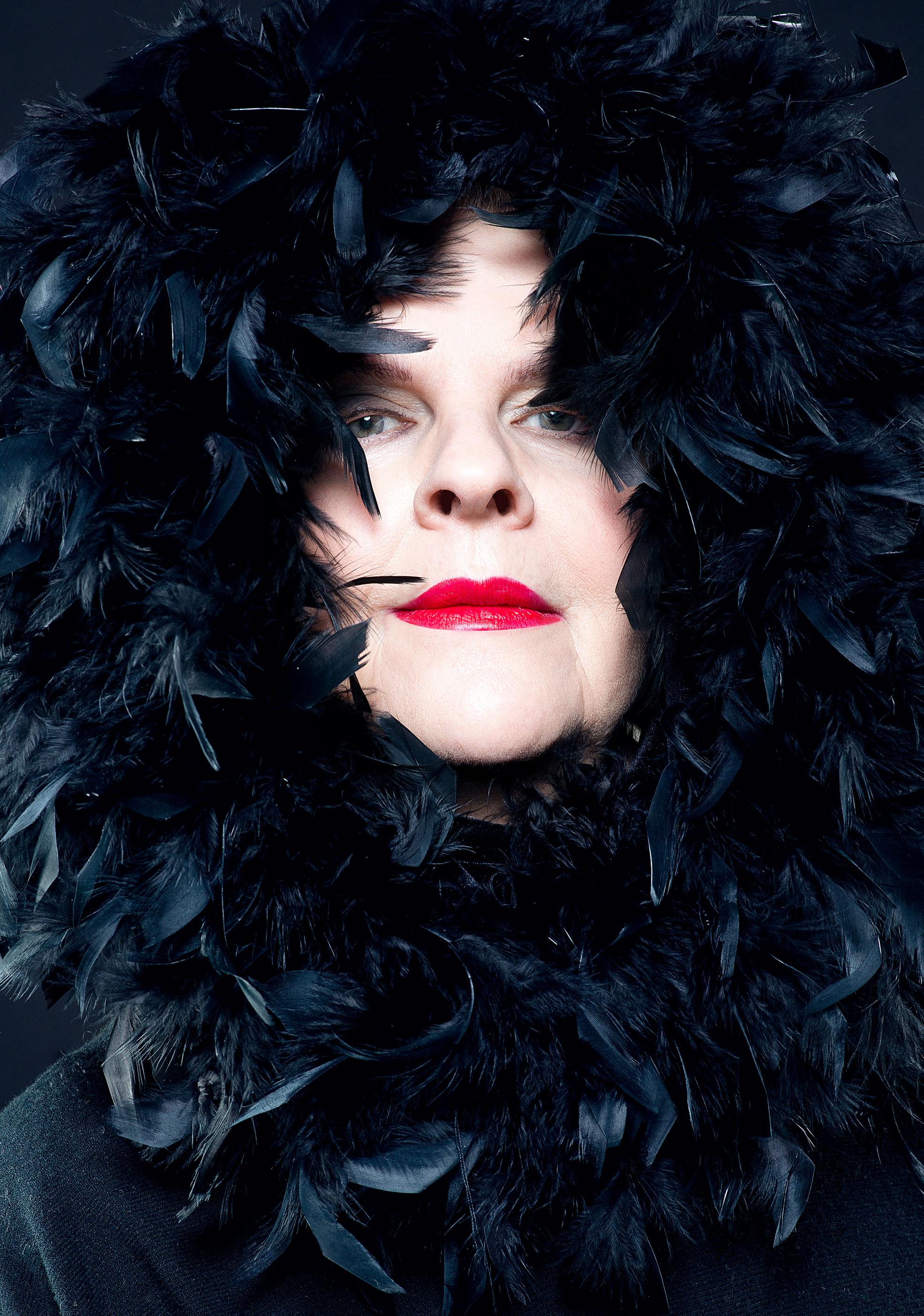 Portrait of an elderly woman with dark plumage Make Up By Daniele Francolino Photographer Maria Teresa Furnari