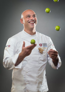 Portrait of a chef with lemons flying Phot