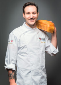 Portrait of a Chef with crusty bread on his shoulder Photographer Maria Teresa Furnari