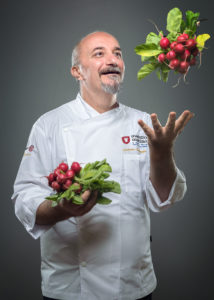Portrait of a chef with radish flying Photographer Maria Teresa Furnari