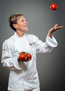 Portrait of a chef with tomatoes flying Photographer Maria Teresa Furnari