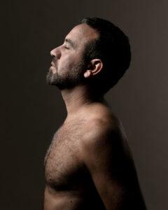 portrait of the designer Antonio Aricò in profile and with his eyes closed Photographer Maria Teresa Furnari