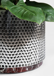 Close Up of Metal Vase medium size with red marble design by Derek Castiglioni Photographer Maria Teresa Furnari